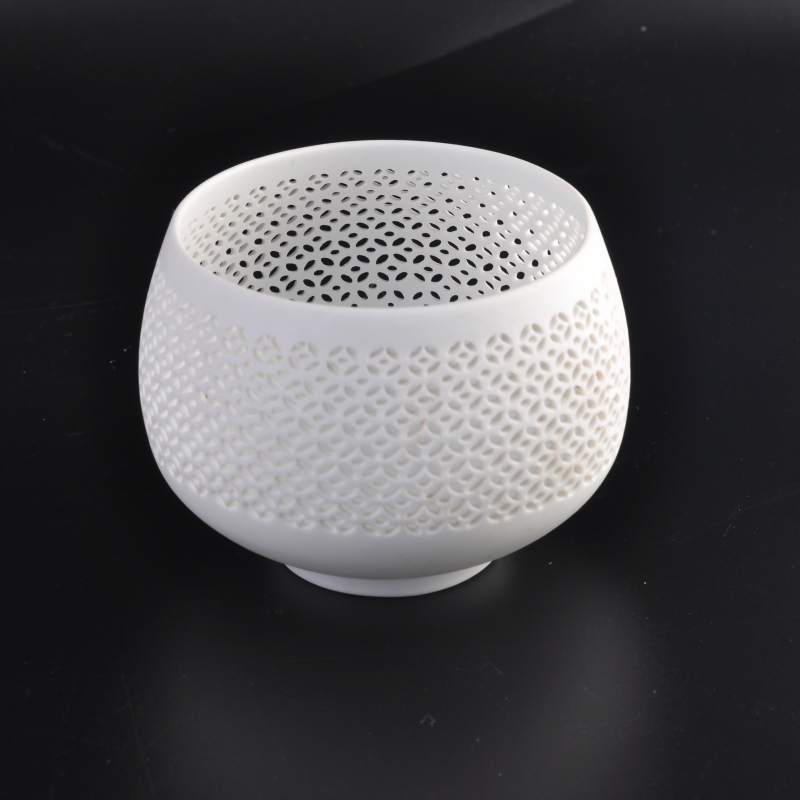 Oval hollowed-out ceramic candle holder for home decoration