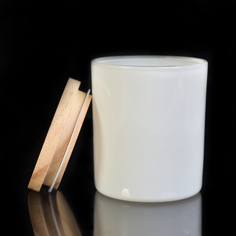 white glass candle holder with wood lid