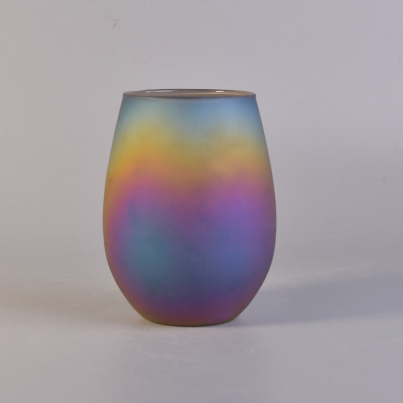 Oval iridescent glass candle vessel