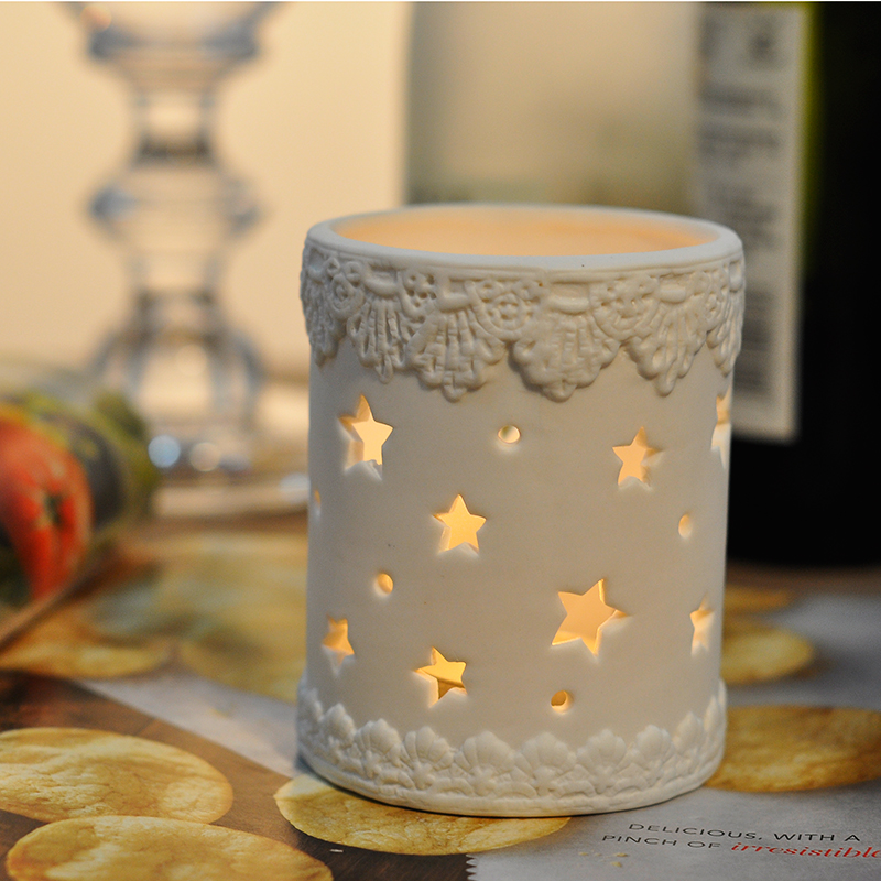 Hollowed-out ceramic candle holder