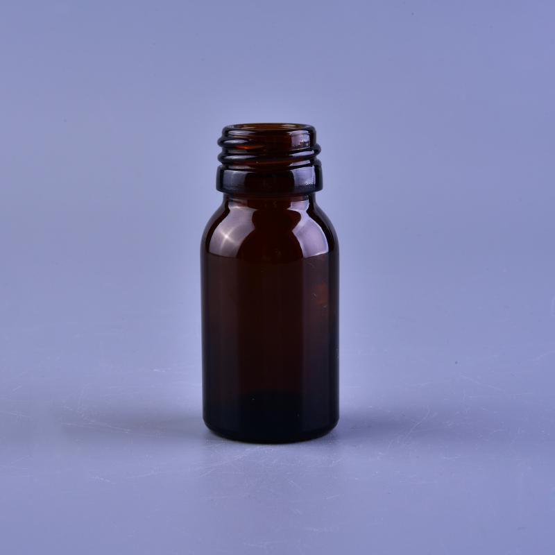 Small screw top amber glass bottle for medicine