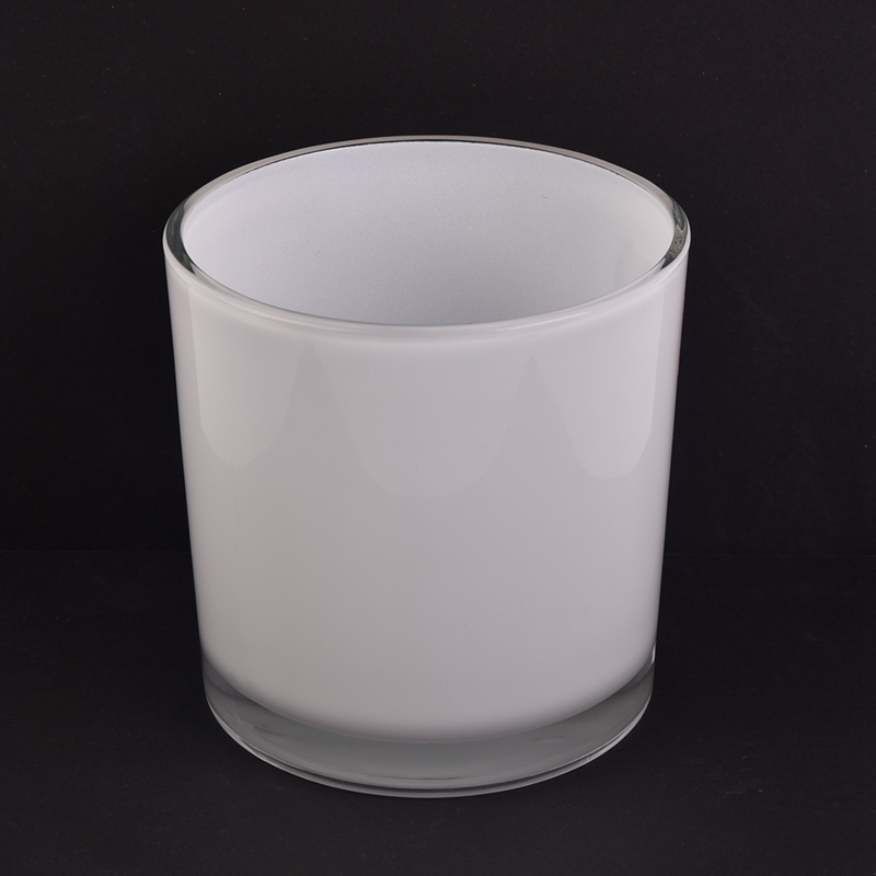 white glass candle jar
