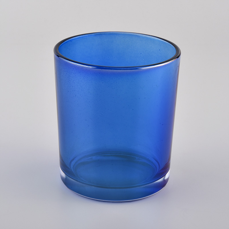 Shiny transparent glass candle vessels