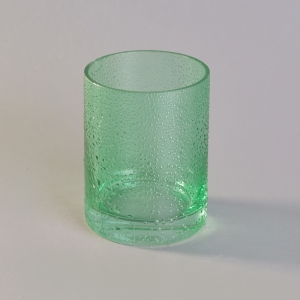 Hand made green glass candle jar with rain drop finish