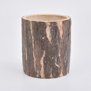 Natural concrete candle holders with bark surface