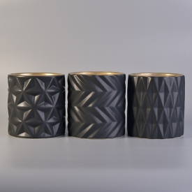 China Matt black engraved cylinder ceramic candle jars wholesale factory