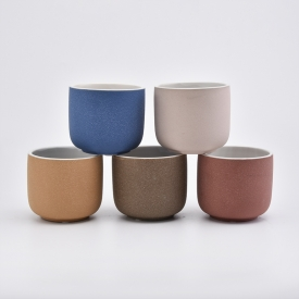 China New arrival sanding color ceramic candle jars wholesale fábrica
