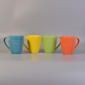 China Orange wholesale ceramic candle cup with handle factory