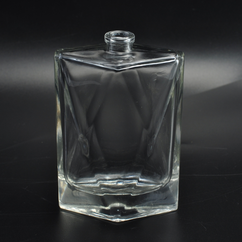 Special shape unique glass clear perfume bottle on for Unique glass bottles